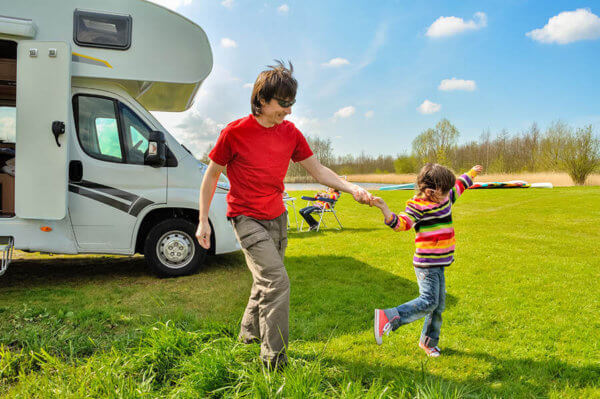 family with caravan at holiday park